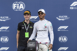 Lewis Hamilton, Mercedes-AMG F1 with the Pole Position Award in parc ferme with professional road cyclist Simon Yates