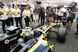 Aseel Al-Hamad, returns to the pits after driving a 2012 Lotus E20 Renault F1 car in the Renault Passion Parade