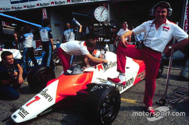 McLaren chief designer John Barnard stands by a McLaren MP4/1B Ford