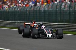 Romain Grosjean, Haas F1 Team VF-17, pulls ahead of Fernando Alonso, McLaren MCL32