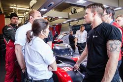 Audi Sport Team Joest team members and race engineer Leena Gade confer