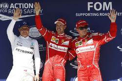 Il poleman Sebastian Vettel, Ferrari, il secondo qualificato Kimi Raikkonen, Ferrari, il terzo qualificato Valtteri Bottas, Mercedes-Benz F1