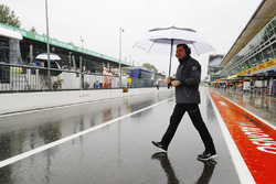 Eric Boullier, Racing Director, McLaren, in the wet pit lane