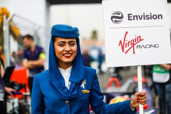 A Saudia Airlines representative holds the grid sign for Envision Virgin Racing