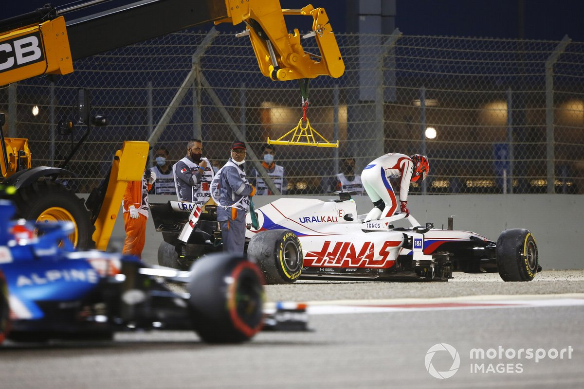Nikita Mazepin, Haas VF-21, climbs out of his car after a crash on the opening lap