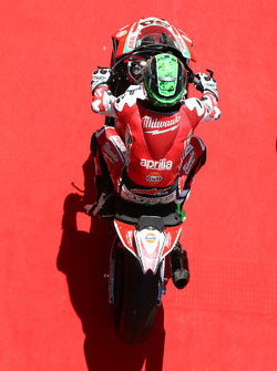 Eugene Laverty, Milwaukee Aprilia rides down the red carpet after taking 3rd in qualifying