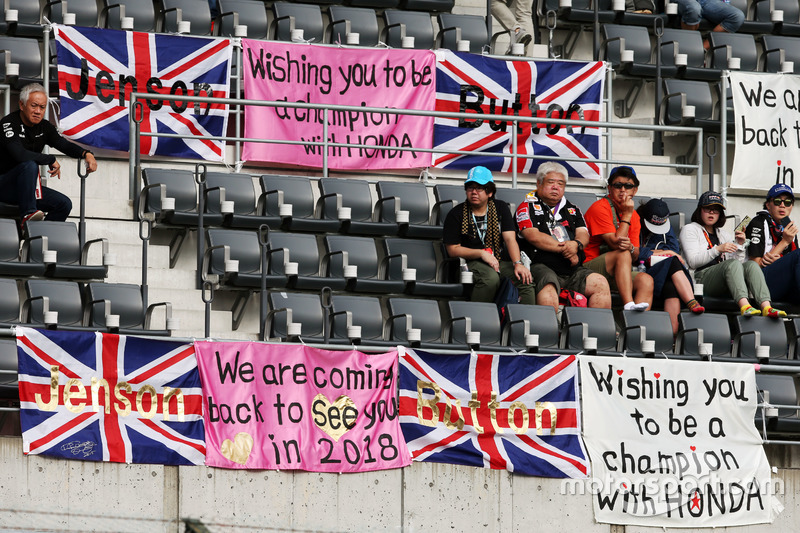 Fans in the grandstand and banners for Jenson Button, McLaren