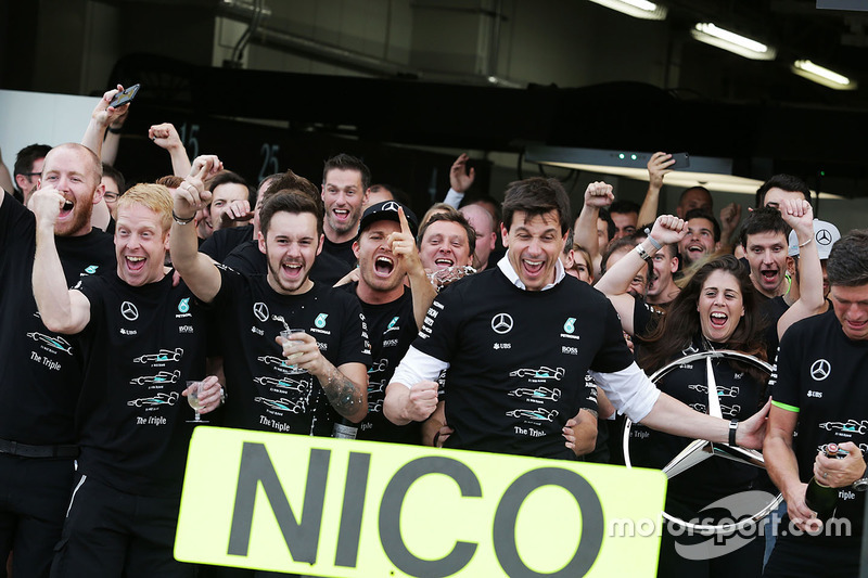 Race winner Nico Rosberg, Mercedes AMG F1 celebrates the Constructors' title with Toto Wolff, Mercedes AMG F1 Shareholder and Executive Director, and the team