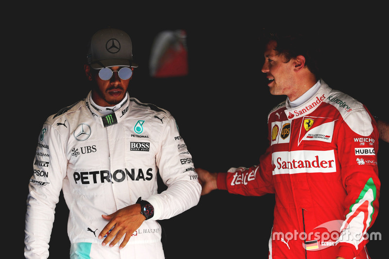 (L to R): Pole sitter Lewis Hamilton, Mercedes AMG F1 with third placed Sebastian Vettel, Ferrari in parc ferme
