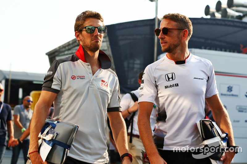 (L to R): Romain Grosjean, Haas F1 Team with Jenson Button, McLaren