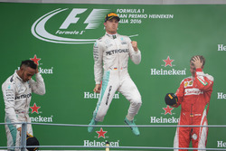 The podium (L to R): second place Lewis Hamilton, Mercedes AMG F1; Race winner Nico Rosberg, Mercede