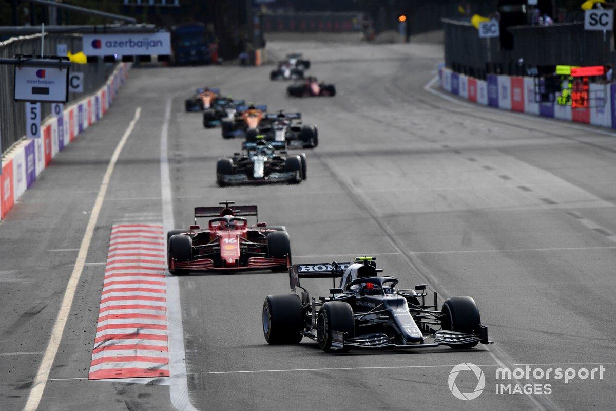 Pierre Gasly, AlphaTauri AT02, Charles Leclerc, Ferrari SF21, and Sebastian Vettel, Aston Martin AMR21