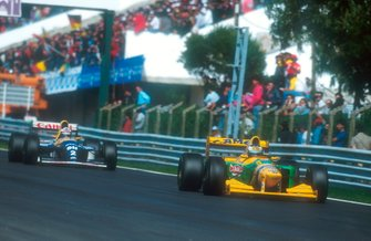 Michael Schumacher, Benetton B193B followed by Alain Prost, Williams FW15C