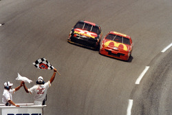 Jimmy Spencer takes the checkred flag ahead of Ernie Irvan