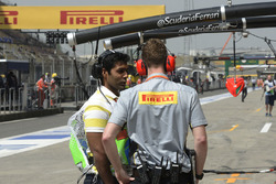 Karun Chandhok, Channel 4 Technical Analyst talks with a Pirelli engineer