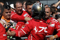 Sebastian Vettel, Ferrari celebrates in parc ferme, the team