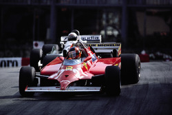 With 4 laps to go Gilles Villeneuve takes the lead from Alan Jones' Williams