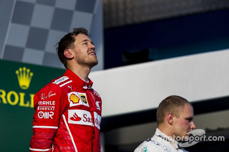 Sebastian Vettel, Ferrari, 1st Position, and Valtteri Bottas, Mercedes AMG, 3rd Position, on the podium
