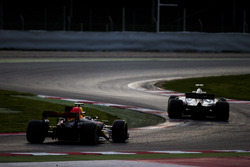 Romain Grosjean, Haas F1 Team VF-17, leads Max Verstappen, Red Bull Racing RB13