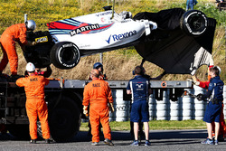 The Williams FW40 of Lance Stroll, Williams is recovered on the back of a truck