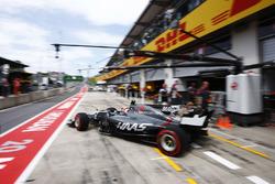 Kevin Magnussen, Haas F1 Team VF-17, leaves his pit garage