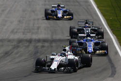 Lance Stroll, Williams FW40, Marcus Ericsson, Sauber C36, Romain Grosjean, Haas F1 Team VF-17