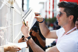 Cyclist Mark Cavendish signs autographs for fans