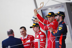 Race winner Sebastian Vettel, Ferrari, second place Kimi Raikkonen, Ferrari, third place Daniel Ricciardo, Red Bull Racing
