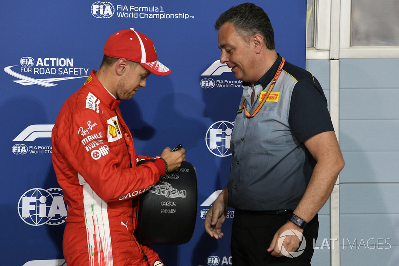 Sebastian Vettel, Ferrari receives the Pirelli Pole Position award from Mario Isola, Pirelli Sporting Director