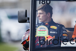 Max Verstappen, Red Bull Racing, gets a lift back to his garage after retiring from the race