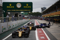 Nico Hulkenberg, Renault Sport F1 Team RS17, Brendon Hartley, Scuderia Toro Rosso STR12, Carlos Sainz Jr., Renault Sport F1 Team RS17, Marcus Ericsson, Sauber C36, Esteban Ocon, Sahara Force India F1 VJM10, queue to leave the pits at the start of Qualifying