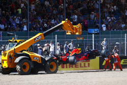 Marshals remove the wrecked Max Verstappen Red Bull Racing RB14