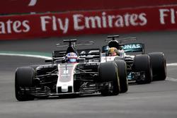 Romain Grosjean, Haas F1 Team VF-17 and Lewis Hamilton, Mercedes-Benz F1 W08  battle