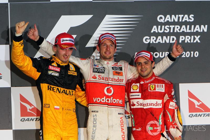 Подиум: второе место – Роберт Кубица, Renault F1 Team, победитель гонки Дженсон Баттон, McLaren, третье место – Фелипе Масса, Ferrari