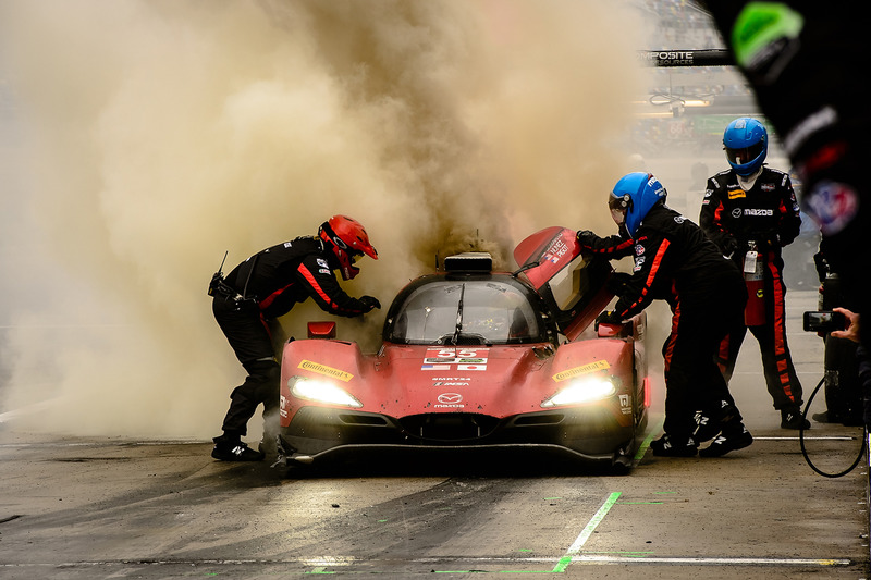 2. #55 Mazda Motorsports Mazda DPi: Jonathan Bomarito, Tristan Nunez, Spencer Pigot, on fire in the pits