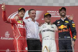 Second place Sebastian Vettel, Ferrari, Race winner Third place Valtteri Bottas, Mercedes AMG F1 Daniel Ricciardo, Red Bull Racing