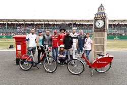 Stoffel Vandoorne, McLaren,Marc Gene of Ferrari and Jenson Button, McLaren, pose with guests and Sky presenter Natalie Pinkham