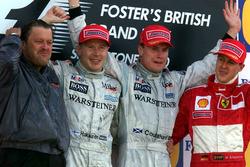 Podium: Race winner David Coulthard, McLaren, second place Mika Hakkinen, McLaren, third place Micha