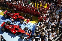 The Ferrari team celebrate by the cars of Sebastian Vettel, Ferrari SF70H, race winner, Kimi Raikkonen, Ferrari SF70H, second place, in Parc Ferme