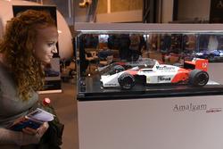 A fan examines an Amalgam 1988 McLaren MP4/4 Honda model