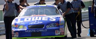 NASCAR Cup Johnson takes pole, sets new record at Kansas