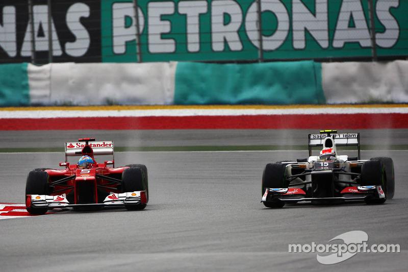 Perez hands Sauber podium in wild, wet Malaysian GP