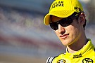 Logano gets back up front to win at Dover