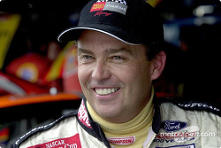 Brett Bodine manages a smile during the rain affected day at Dover