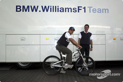 Juan Pablo Montoya receiving his new toy from Dr. Mario Theissen: a BMW mountain bike
