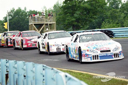 Kenny Wallace leads a pack of cars down the hill