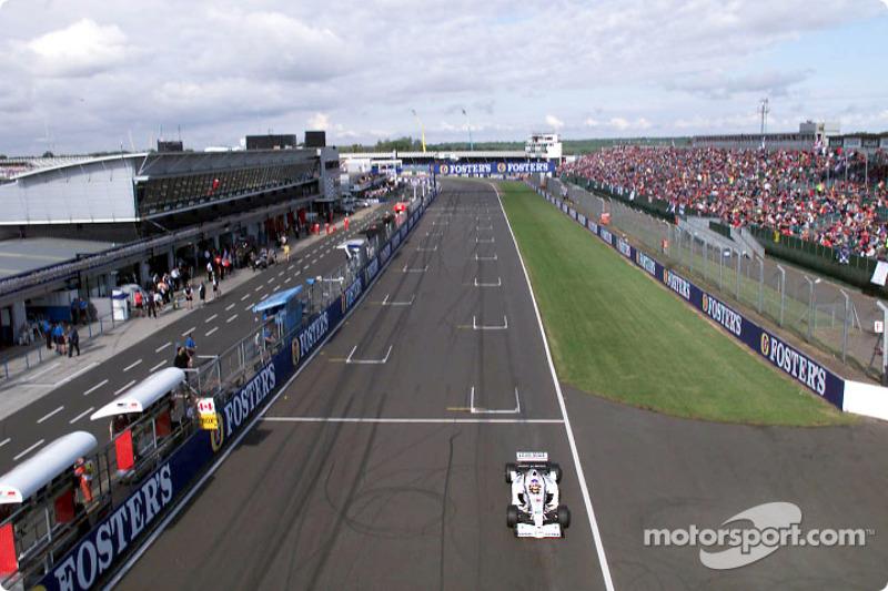 Jacques Villeneuve passing the pits
