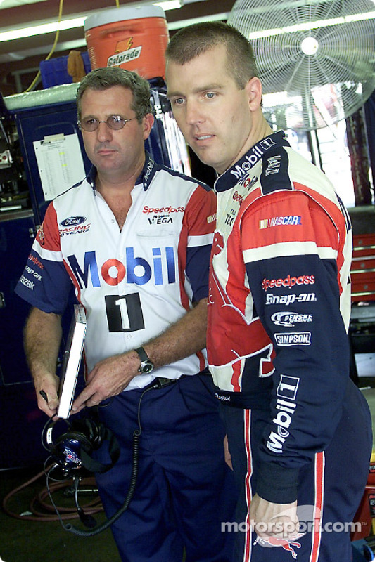 Jeremy Mayfield and crew chief Peter Sospenzo discuss car setup in the garage area
