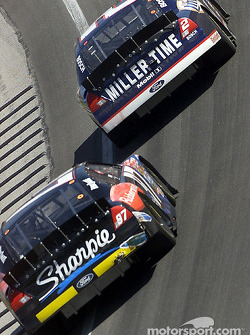 Rusty Wallace leads rookie Kurt Busch in turn one