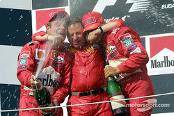 Rubens Barrichello, Jean Todt and Michael Schumacher celebrating